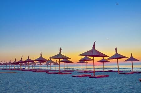Sunrise under parasol on the Black Sea  beach Stock Photo - 21885639