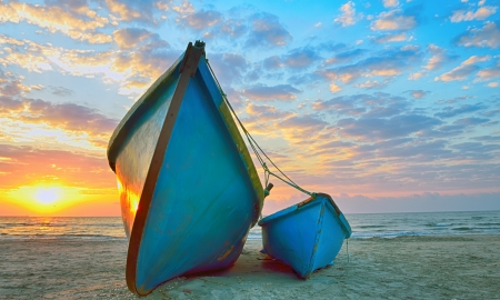 Fishing boats and sunrise on Black Sea beach photo