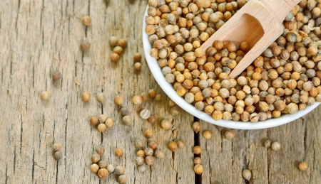 Coriander seeds isolated on a wooden background Stock Photo - 21885674