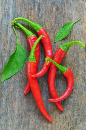 Red chili peppers over wooden background Stock Photo - 21885678