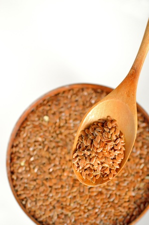flax seeds shoot on wood, white background photo