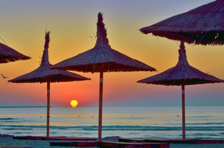 Sunrise under parasol on the Black Sea  beach Stock Photo - 21885681