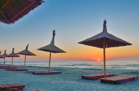Sunrise under parasol on the Black Sea  beach Stock Photo - 21885682