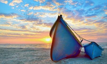blue fisherman boats and sunrise