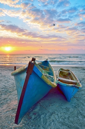 moored: blue fisherman boats and sunrise