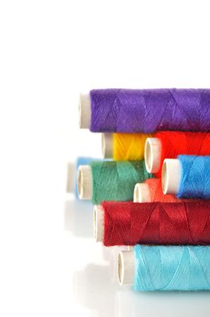 lurex: Pile of coloured bobbins shoot in studio Stock Photo