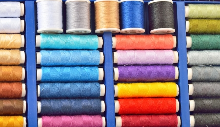 colored spools of threads shoot in studio Stock Photo - 23000470