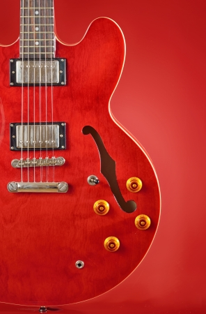 red guitar isolated on red Stock Photo - 23000540