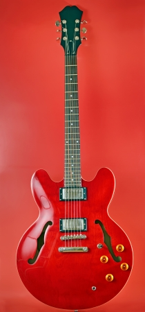 red electric guitar shoot in studio Stock Photo - 23000550