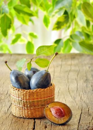 plums in the basket shoot in studio Stock Photo - 23000555