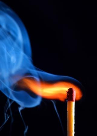 lighting a match on black background Stock Photo - 23216289