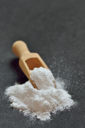 sodium hydrogen carbonate: baking soda on black  Stock Photo