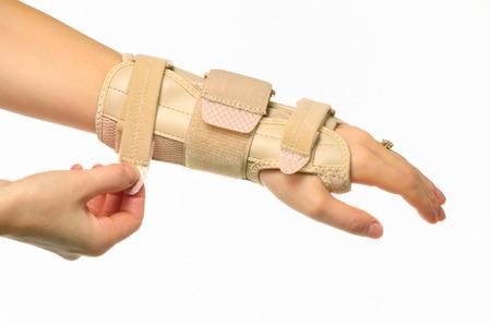 hand met een pols brace geïsoleerd Stockfoto