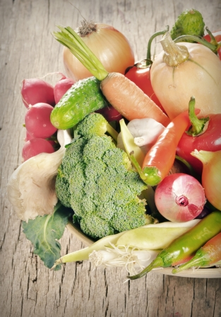 Fresh vegetables in  basket on wooden table Stock Photo - 23812564