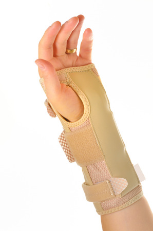 hand with a  orthopedic wrist brace  Stock Photo