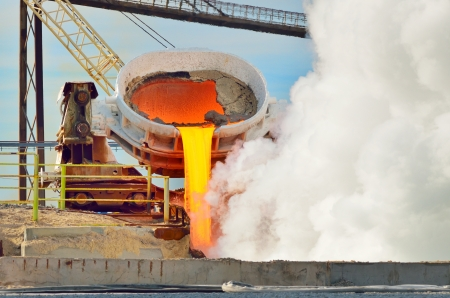 hot steel pouring in steel plant. Production of cast iron in steel mills Standard-Bild