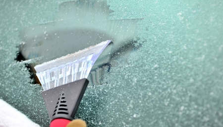 windscreen wiper: scraping snow and ice from the car windscreen