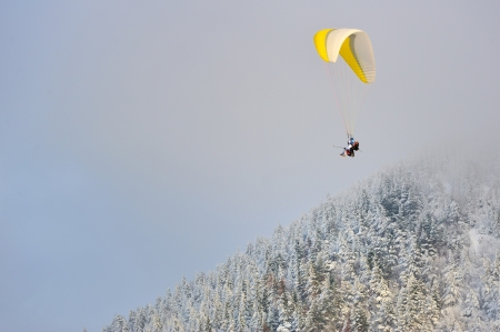 paragliding in winter over the mountains Stock Photo - 23812641