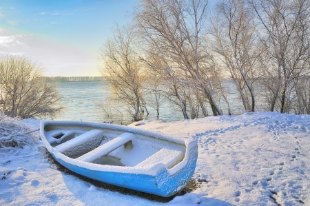 boat near danube river shoot at sunrise in winter day