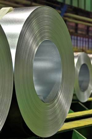 tinplate: packed rolls of steel sheet in a warehouse Stock Photo