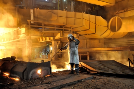prefabricate: worker with hot steel in plant