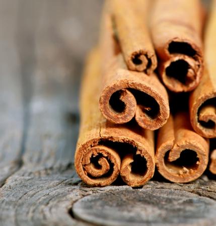 Bunch of cinnamon sticks on old wood Stock Photo