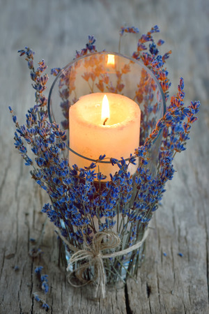candle and lavender on old wood