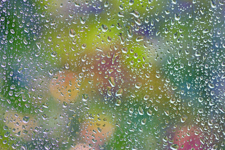 Rain drops on a window. Abstraction Stock Photo