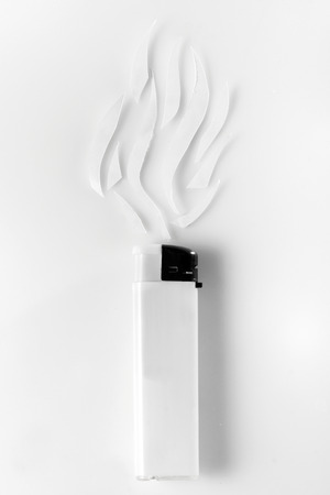 white lighter and abstract smoke on white background photo
