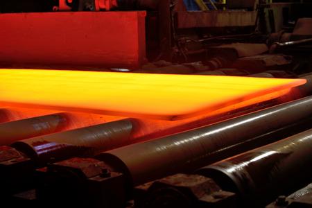 hot steel on conveyor, isolated photo