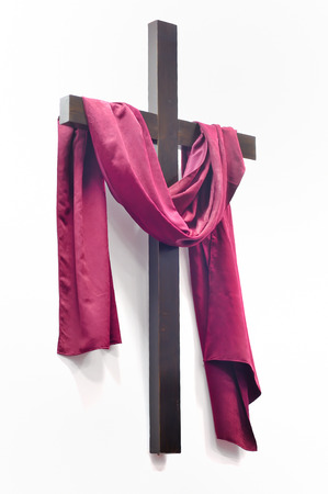 christ is risen easter: cross with red clothing on white background Stock Photo