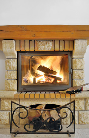 stone fireplace: Fire in fireplace. Close Up of firewood burning in fire Stock Photo
