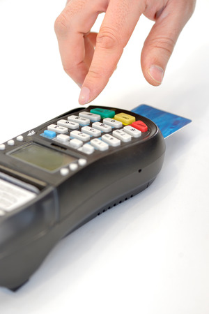 enters: Male hand enters PIN code on payment terminal isolated on white background Stock Photo