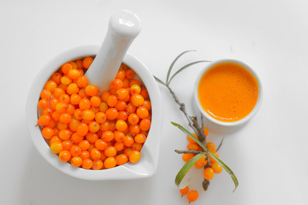 sea buckthorn berries and juice isolated