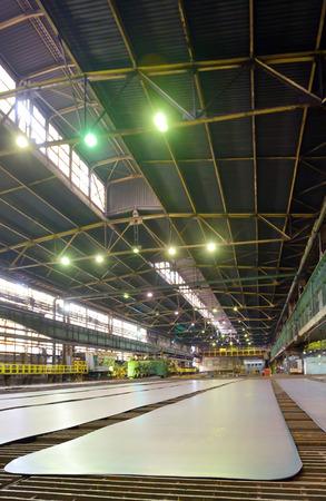 steel plate on conveyor inside of plant