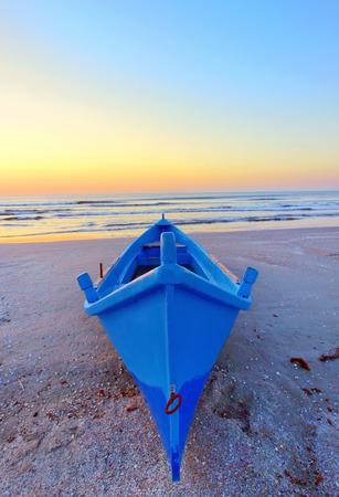 blue Fishing boats and sunrise on Black Sea beach photo