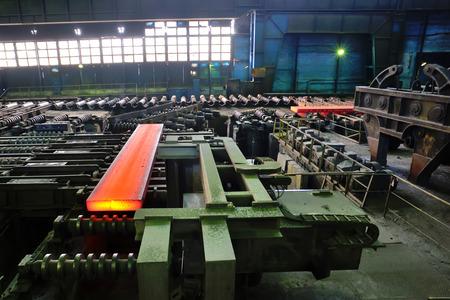 hot steel plate on conveyor inside of steel plant photo