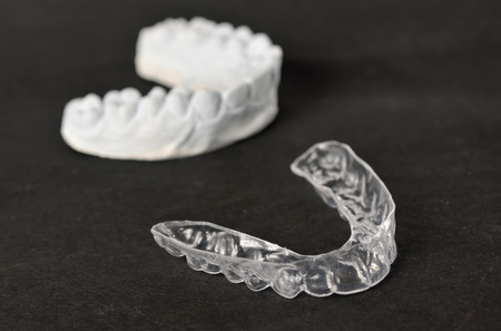 impressions: Silicone dental tray and mold isolated Stock Photo