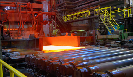 burner: hot steel sheet on conveyor; sheet metal Stock Photo