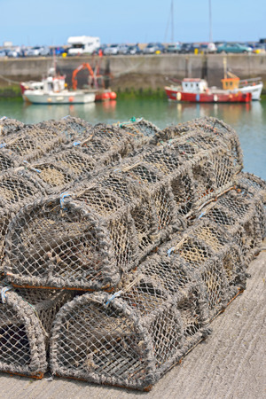 lobster pots: groups of traditional traps for capture fisheries and seafood on the ireland coast