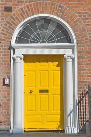 View of a Yellow Georgian door in Dublin Ireland photo