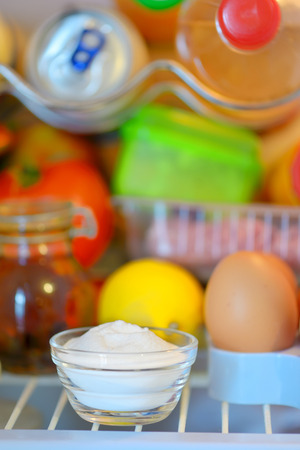 smelly: bicarbonate inside of fridge to absorb odours Stock Photo