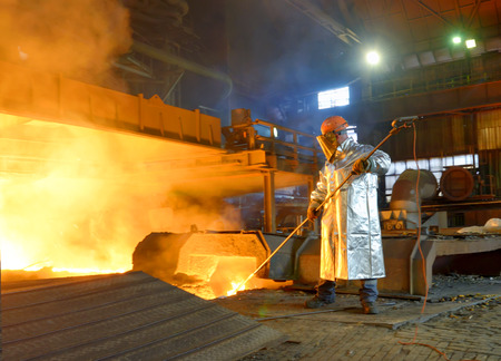steel factory: Industrial worker in steel making factory