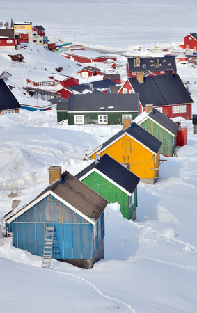 inuit: colorful inuit  houses in Greenland