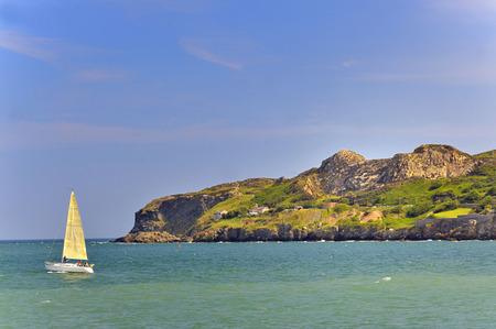 quietude: sailboat on atlantic of ireland in summer Stock Photo