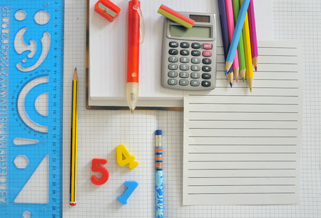 posits: School supplies with blank paper on the school desk