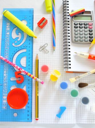posits: School supplies  on the school desk