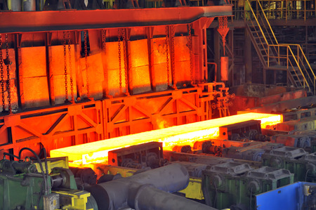 red hot iron: hot steel on conveyor in plant