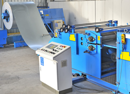 automatically: industrial machine for cutting steel sheets Stock Photo
