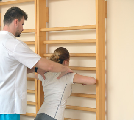 muscle toning: elongation treatment of low back pains with instructor